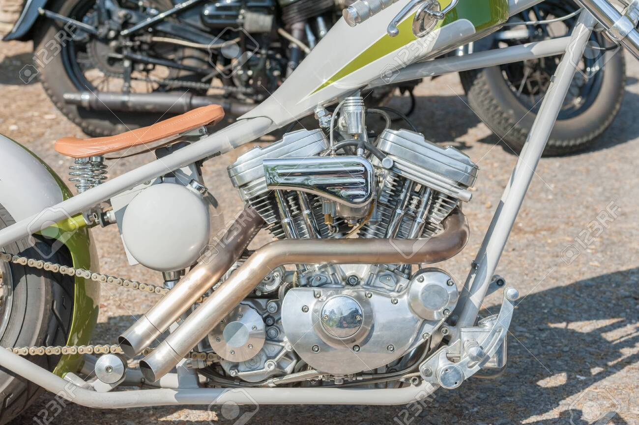 chromed custom motorcycle engine and exhaust pipe closeup stock photo picture and royalty free image image 143026447