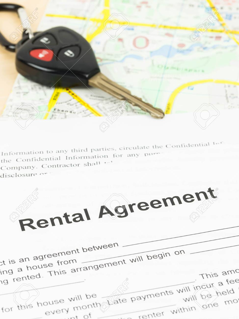 Car Rental Agreement With Key And Map Stock Photo - 32254658