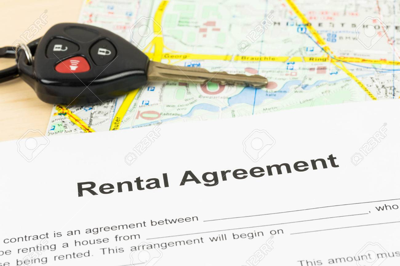Car Rental Agreement With Key And Map Stock Photo - 32254561