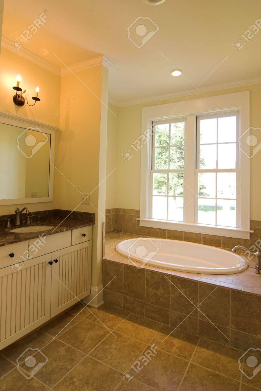 elegant bathroom in tan tile
