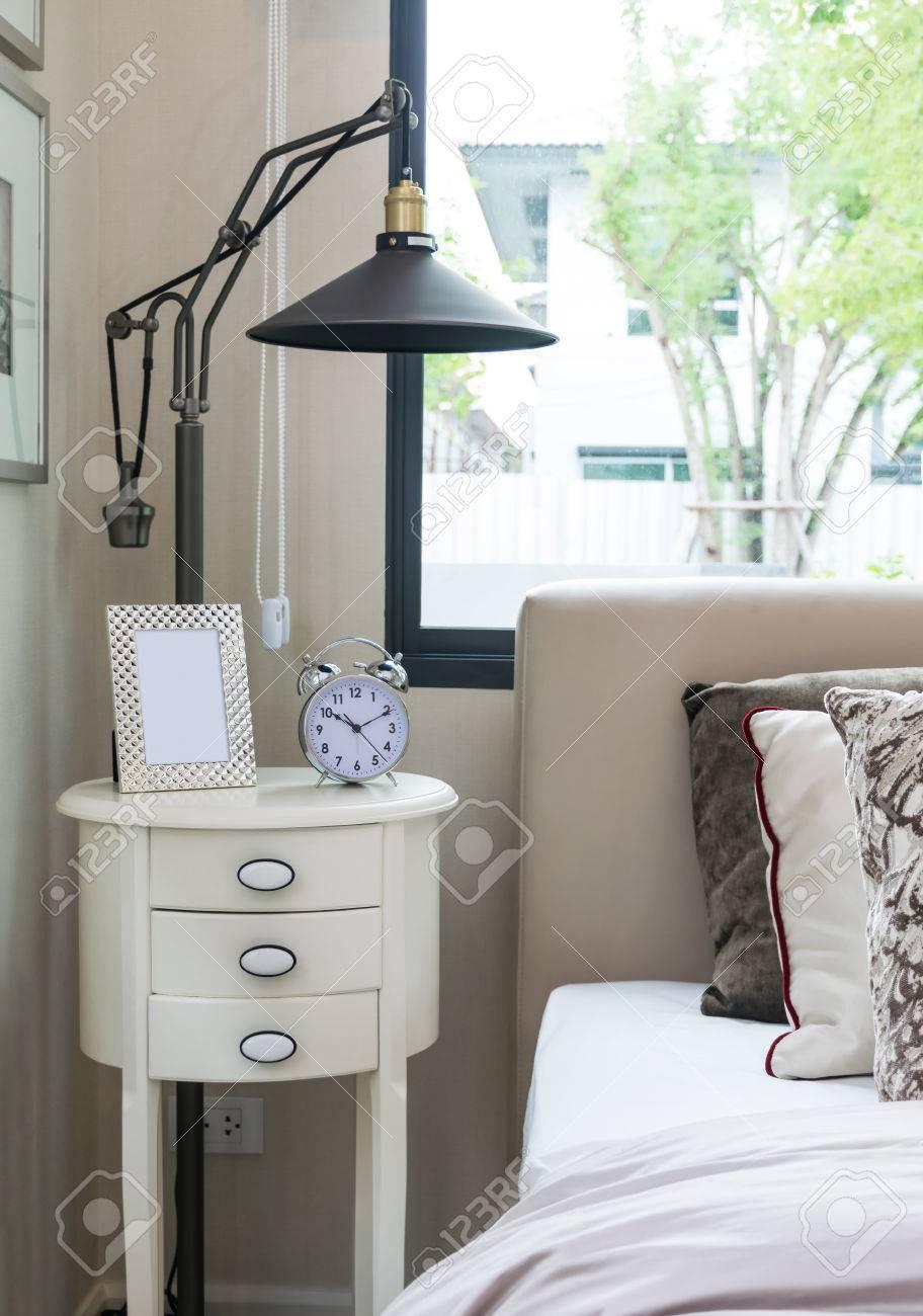 Wonderful Alarm Bedside - 36614114-black-lamp-picture-frame-and-alarm-clock-on-bedside-table  Collection_73814.jpg