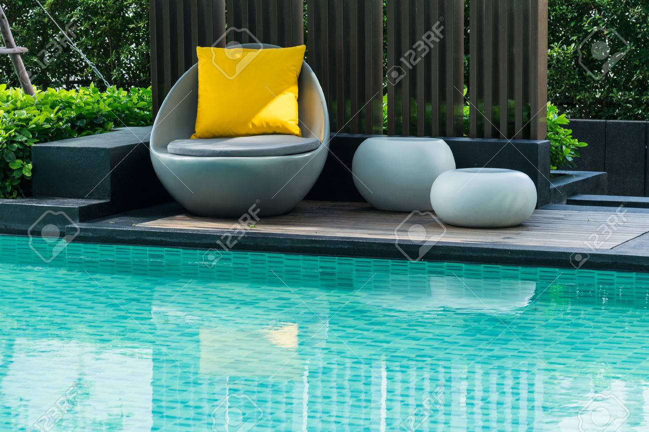 Chairs For Pool Relaxing Chairs With Pillows Beside Swimming Pool