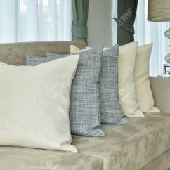 Cushion Ideas For Light Brown Sofa Next And Armchairs Earth Tone Pillows Setting On In The Living Stock Room Photo 58012596