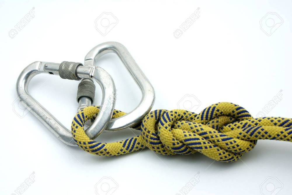 medium resolution of single figure 8 on a bight tied on a yellow rope and master lock stock photo