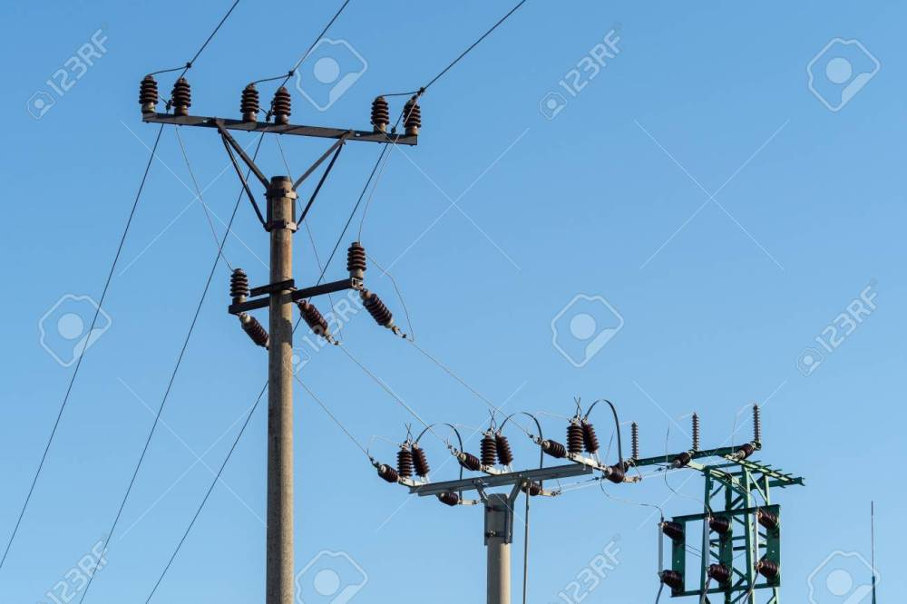 medium resolution of electric column and wires of high voltage on blue sky background stock photo 112606752