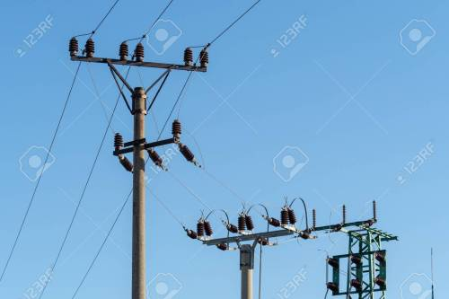 small resolution of electric column and wires of high voltage on blue sky background stock photo 112606752