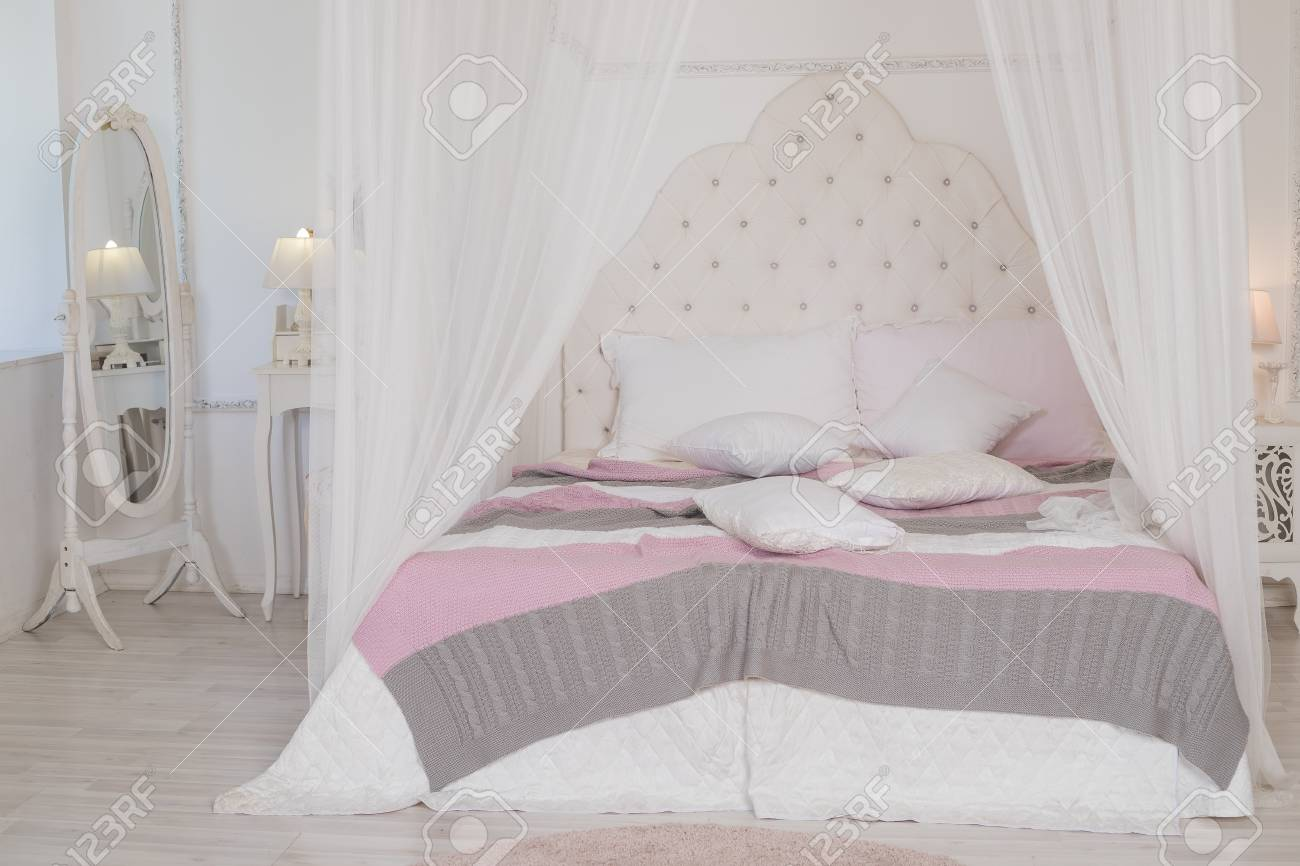 big bed with cute pastel bedding in womans room modern bedroom