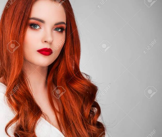 Photoshot Of Gorgeous Redhead Girl With Bright Makeup Stock Photo