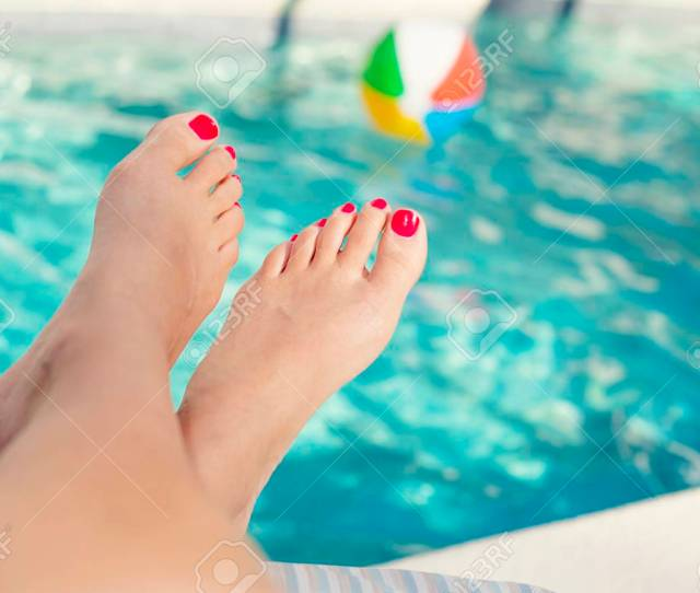 Beautiful Sexy Female Feet Relaxing By The Swimming Pool Great Pedicure Photo Stock Photo