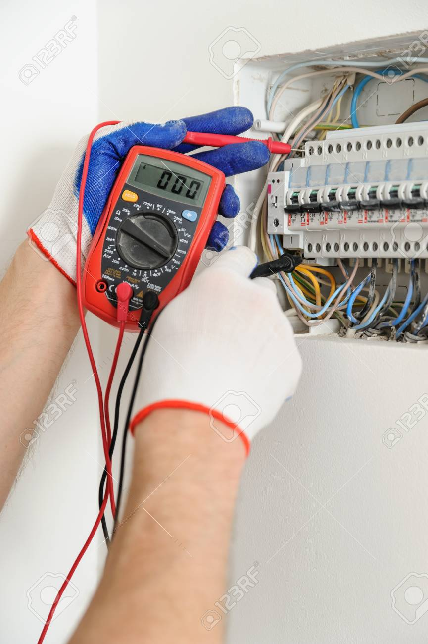 medium resolution of electrician check voltage in electrical fuse box  with a multimeter aluminum wire fuse
