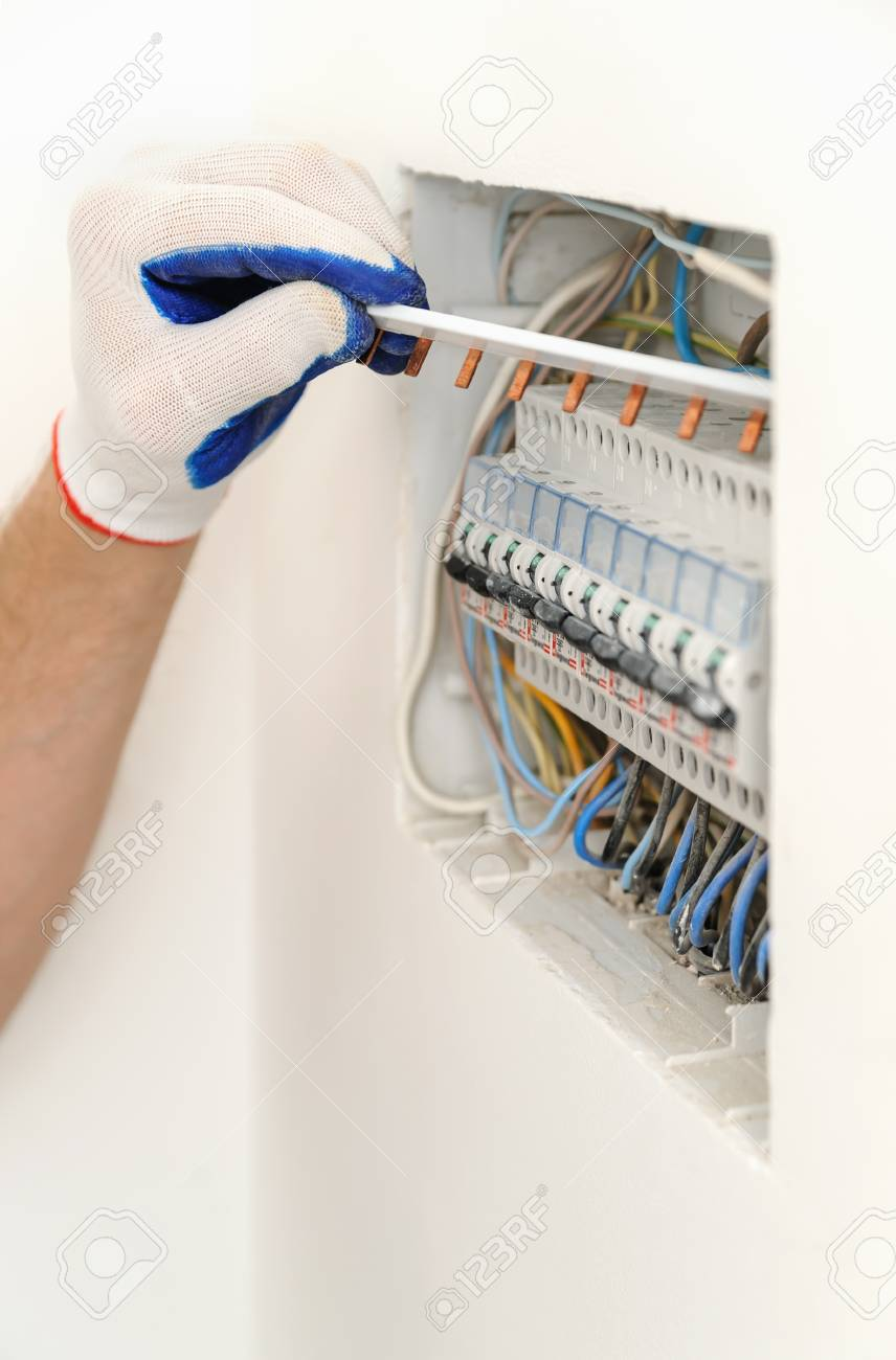 medium resolution of archivio fotografico electrician installing an electrical fuse box in a house