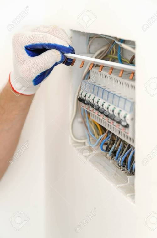 small resolution of archivio fotografico electrician installing an electrical fuse box in a house