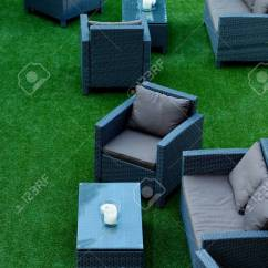 Comfortable Wicker Chairs Desk Chair Covers Dorm Contemporary Lounge Zone With Stock Pillows And Tables On Perfect Green Grass Outdoors
