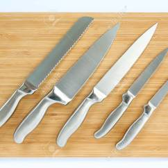 Professional Kitchen Knives Mitts Set Of On A Wood Board Top View Stock Photo 78644893