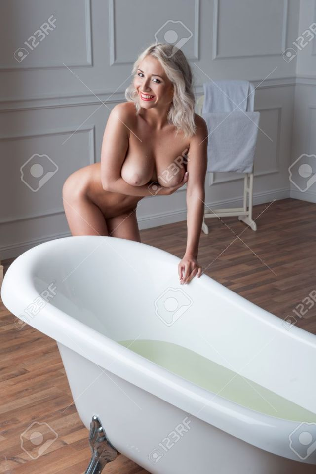 Sexual Blonde Seductive Nude Woman With Big Breast Posing By The Bath In Classical Light Interior