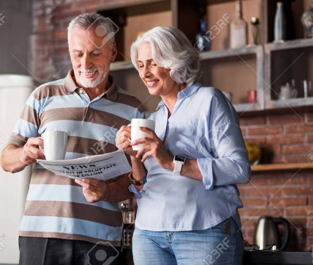 Nice Aged Husband And Wife Sharing The News During Breakfast Stock Photo 63077306