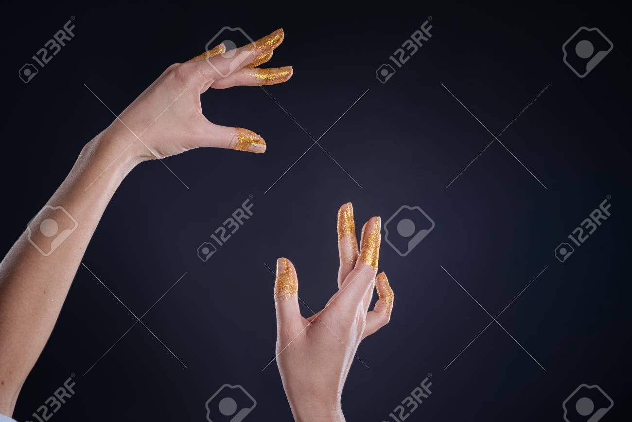 slim hands posing on
