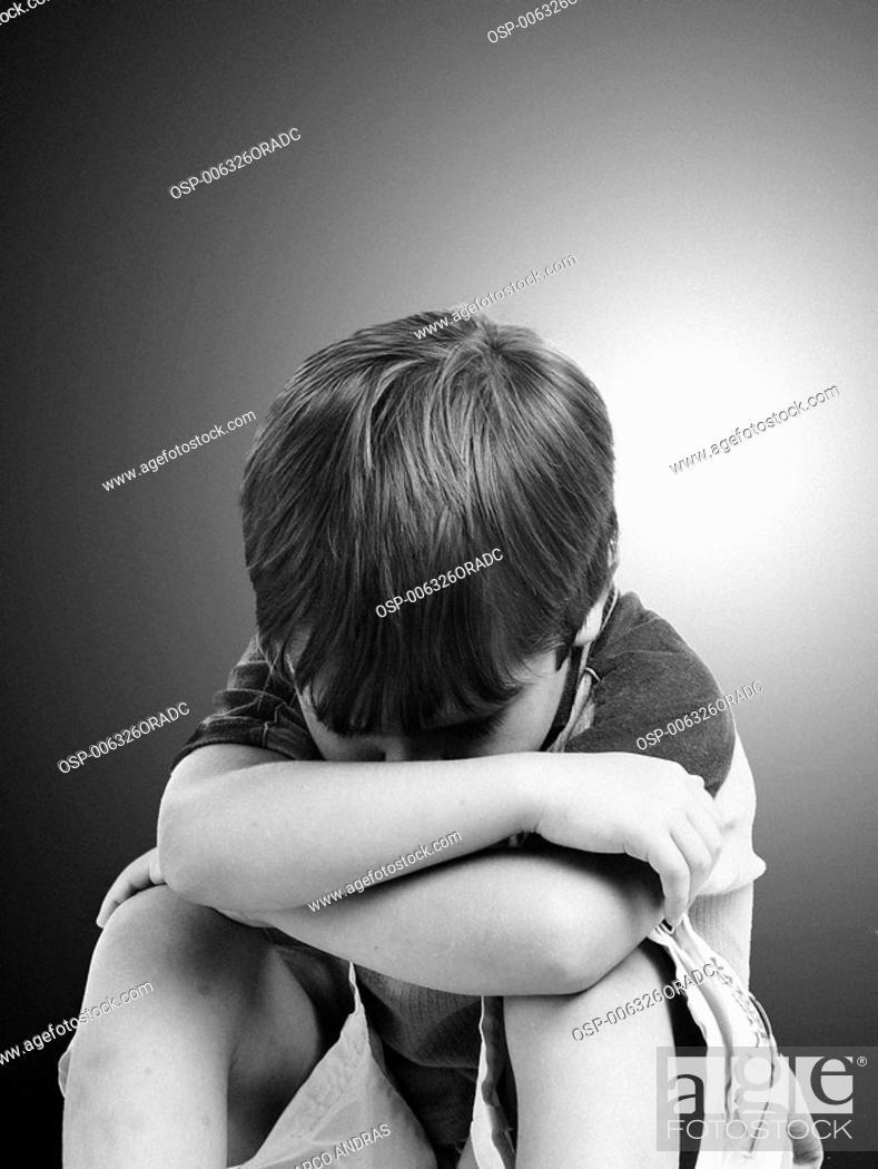 a boy sad in
