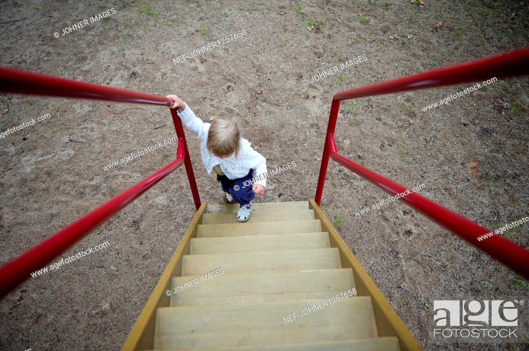 girl climbing steps stock
