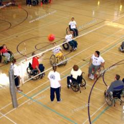 Wheelchair Volleyball Rosewood Dining Chairs Several People With Disabilities Playing A Game Of Stock Photo On An Indoor Court