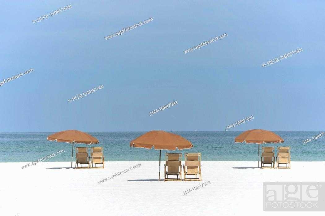 beach chairs with umbrellas lay flat recliner white sand gulf sea mexico stock photo clearwater florida usa united states america