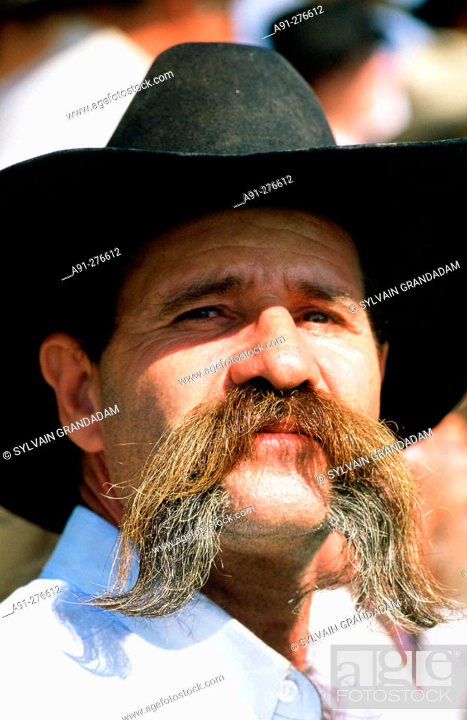 cowboy with mustache at