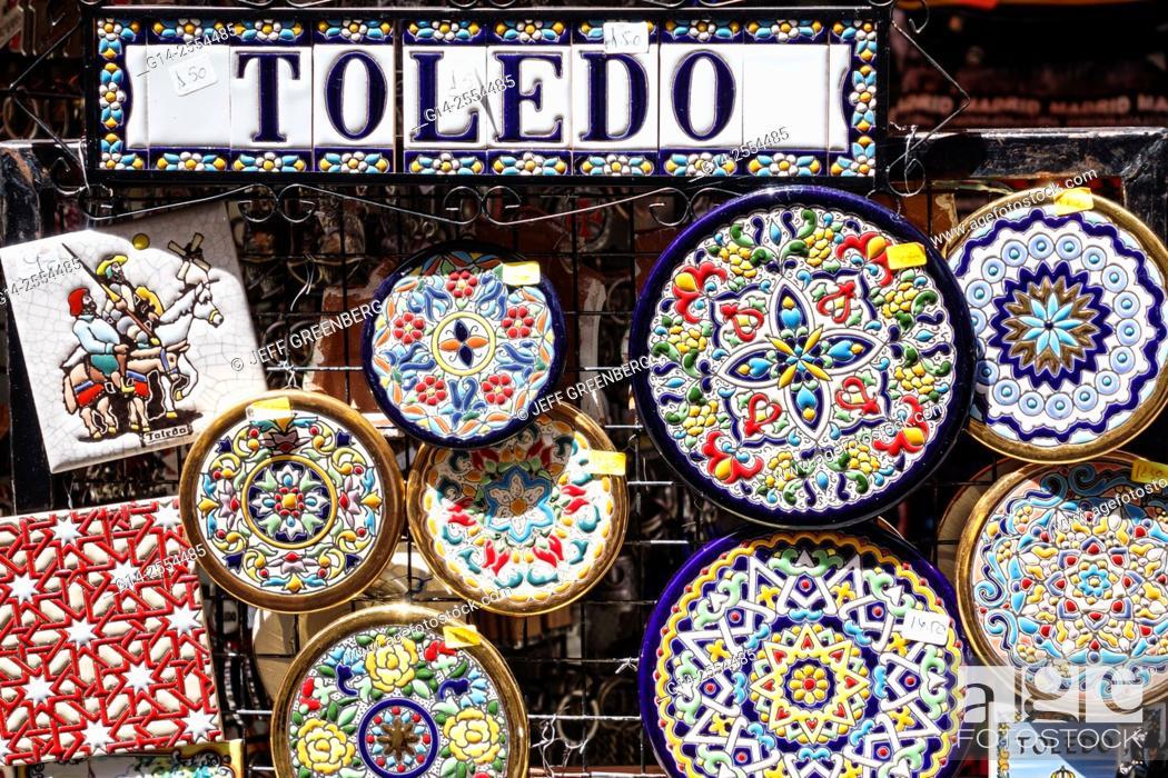 https www agefotostock com age en details photo spain europe spanish hispanic toledo gift shop store business souvenir shopping ceramics pottery talavera hand painted decor plate tile sale g14 2554485