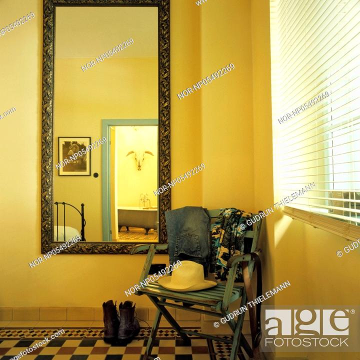 bedroom chair for clothes best leather office corner of a with and mirror the stock photo