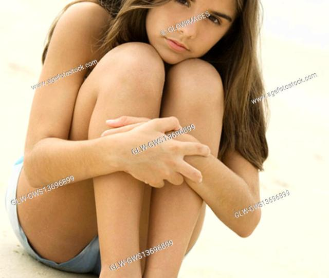 Stock Photo Portrait Of A Teenage Girl Sitting On The Beach