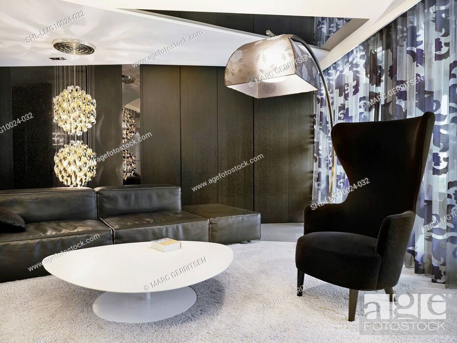 high back chairs living room wall color according to vastu modern with white coffee table and black chair stock photo