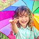 Happy Child Walking In The Rain