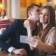 Joyful Loving Couple Enjoying Modern Technology, Having Fun, Capturing Bright Moments of Vacations