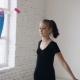 Rhythmic Gymnastics: Cute Teenage Girl Training a Gymnastics Exercise with a Colored Ribbon