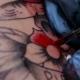 Tattoo Artist Doing a Tattoo in Studio