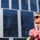 Female Fashion. Street Life. Modern Lifestyle Woman in Sunglasses