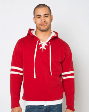 A man wearing a custom red hoodie with white trim and full sleeves. The neck has an open v-neck with white laces crossing like a pair of skate laces.