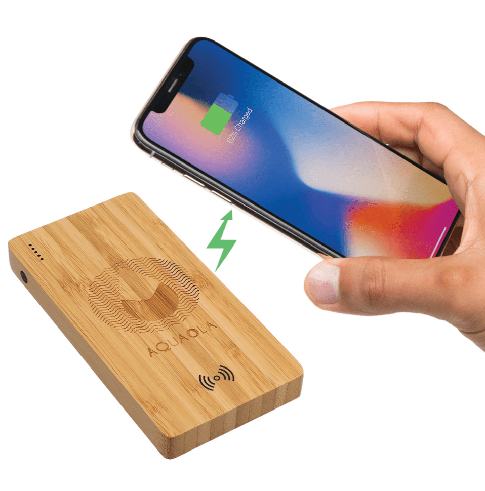 A corporate branded rectangular Bamboo Wireless Power Bank with an iPhone being held over it and a green lightening bolt to simulate the phone being charged wireless.