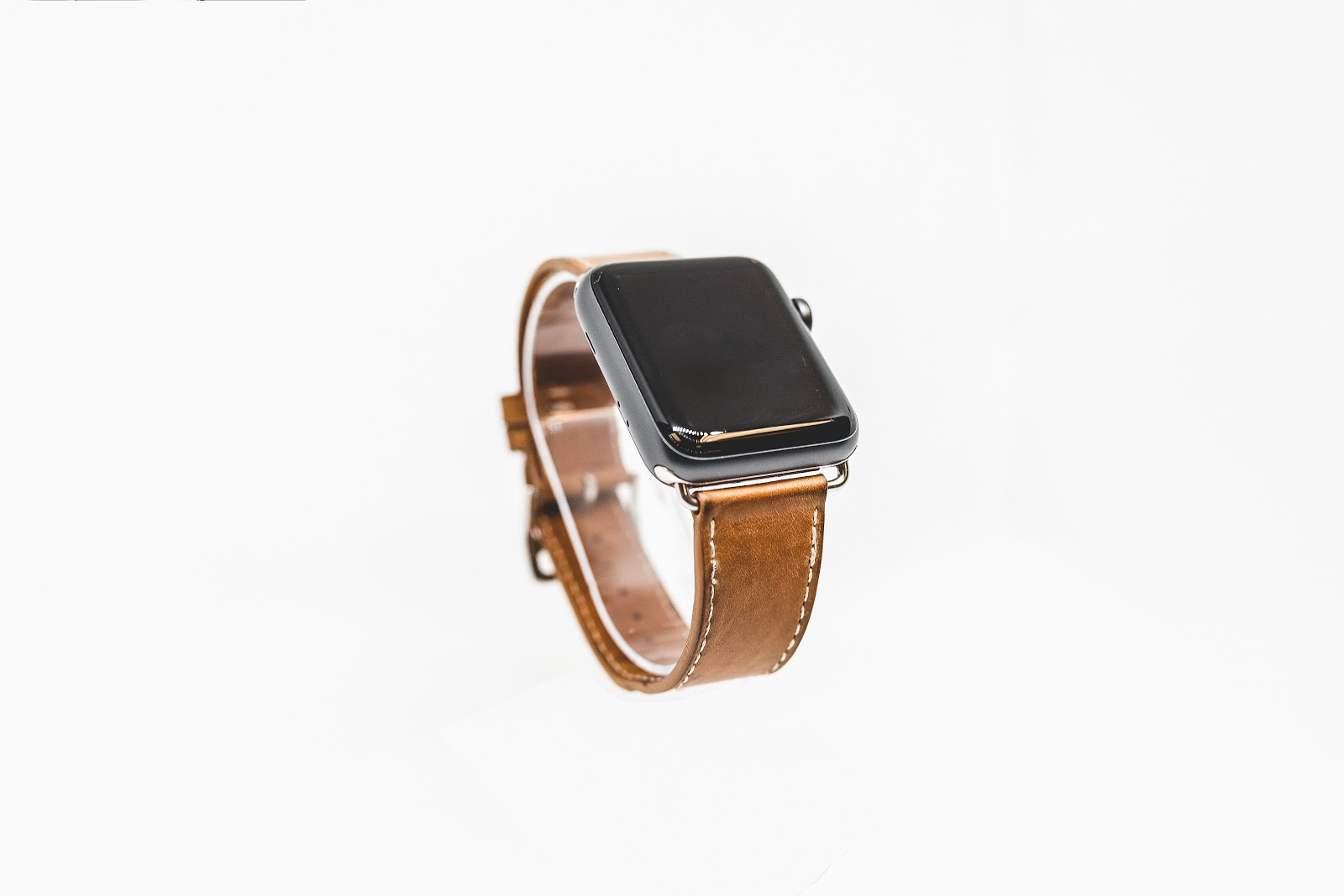 Smart Watch With a brown leather strap.