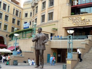 People sitting at Nelson Mandela Square.