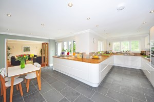 A predominantly white kitchen.