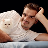 A man moving abroad with pets and a cat