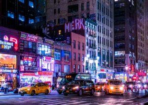 A street in Manhattan by night.