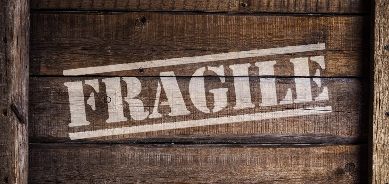 A wooden box with the word fragile written on it.