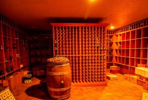 A wine cellar with perfect temperature and dim light is one of the ways for finishing basement in your Texas home.