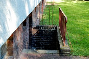 A side entrance with stairs going to the basement.