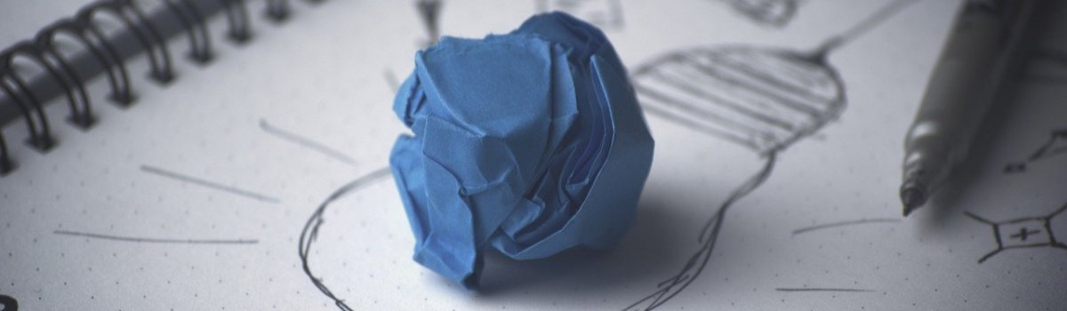 A drawig and a blue paper ball on it.