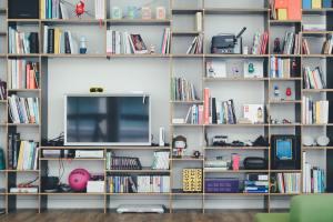 book shelf with TV screen and books in LA studio