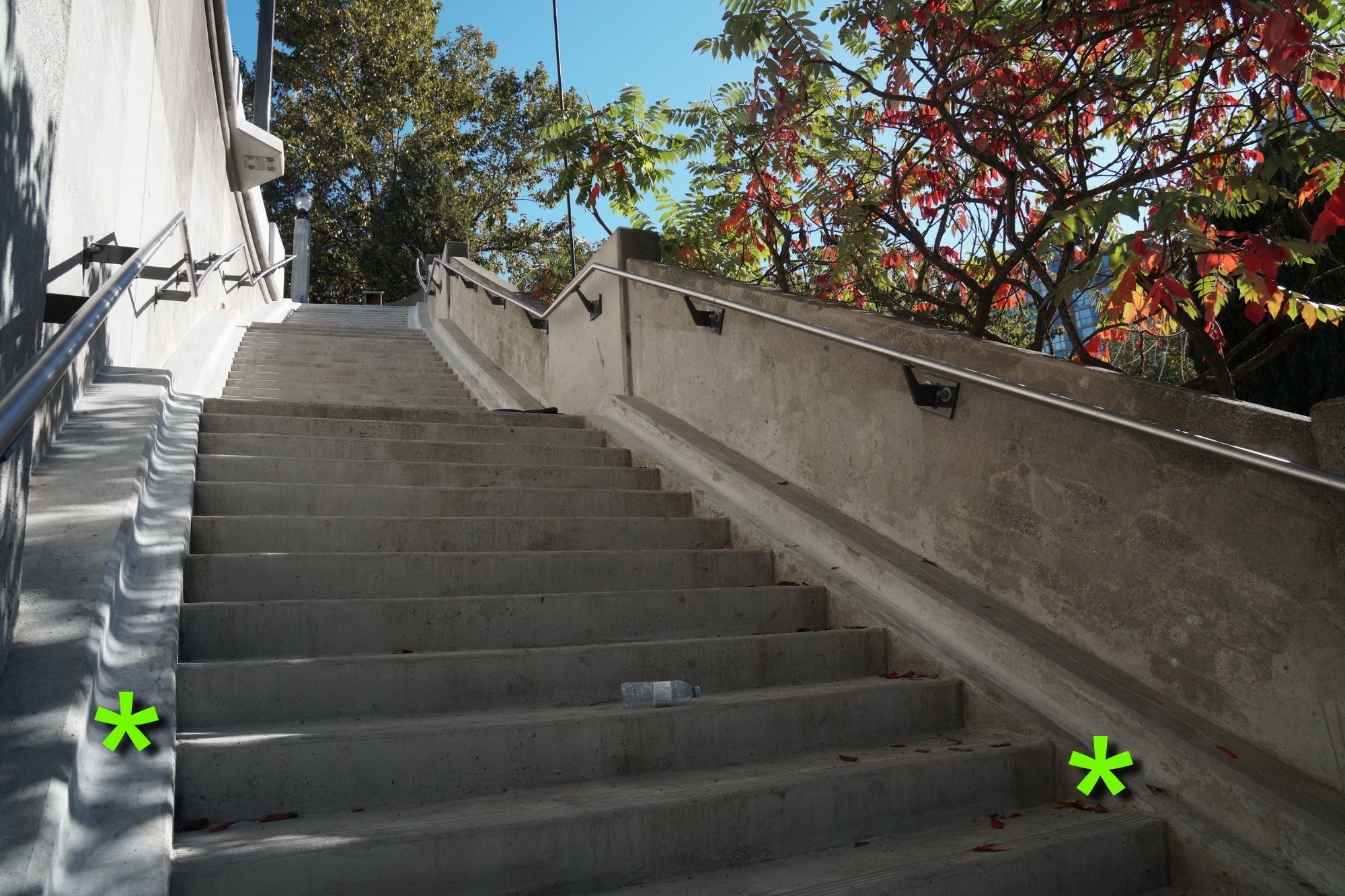 East side stairs, with bike-friendly runnells (*).