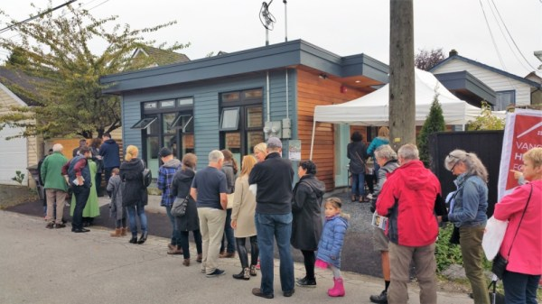 attendees-at-this-year-s-vancouver-heritage-foundation-s-laneway-house-tour-lined-up-to-view-a-small