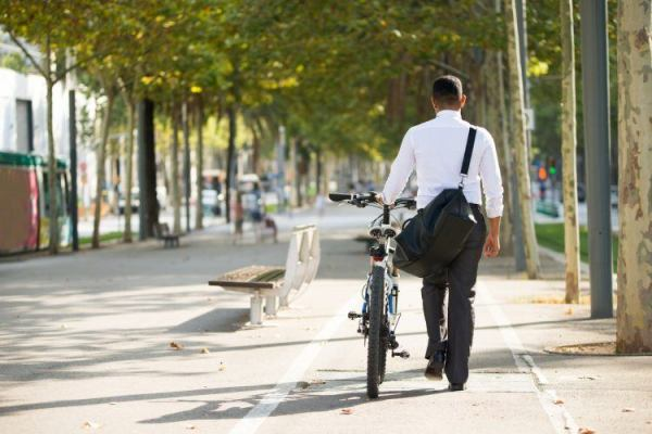 employee-walking-bike-on-way-to-work-750x500